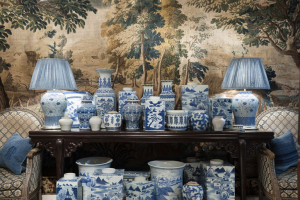 A collection of Chinese blue and white porcelain planters and baluster vases on console table with tapestry back drop Guinevere's antique shop on Kings Road, Chelsea, London, UK